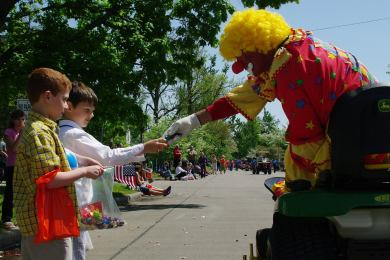 Photo of a clown handing two young boys some candy during the Dogwood-Azalea  Parade 24cbe90bcc11