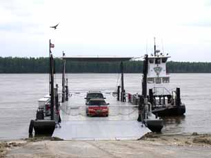 Photo of an automobile boarding the Dorena-Hickman Toll Ferry, Mississippi County, Missouri.
